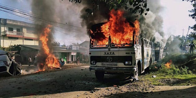 Vehicles are seen burning after being set alight by protesters in Imphal, the capital of Indias northeastern state of Manipur, on December 18, 2016.