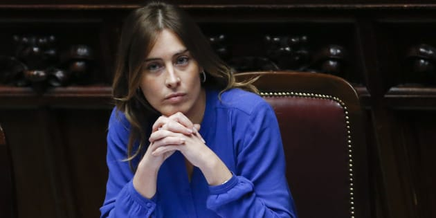 Italy's Minister for Constitutional Reforms and Parliamentary Relations Maria Elena Boschi attends a confidence vote at the lower house of the parliament in Rome February 25, 2014. Prime Minister Matteo Renzi won his first confidence vote in parliament, pledging to cut labour taxes, free up funds for investment in schools and pass wide institutional reforms to tackle Italy's economic malaise. Facing parliament for the first time, the 39-year-old Renzi who is Italy's youngest premier, sketched out an ambitious programme of change in an hour-long speech delivered in his trademark quickfire style interspersed with occasional jeers from the opposition benches.   REUTERS/Giampiero Sposito  (ITALY - Tags: POLITICS BUSINESS)