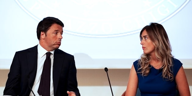 Italy's Prime Minister Matteo Renzi (L) speaks to Italy's Minister for Constitutional Reforms and Parliamentary Relations, Maria Elena Boschi during a news conference at Chigi palace in Rome, Italy, September 1, 2014. REUTERS/Max Rossi/File Photo