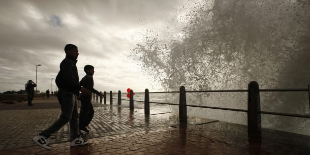 Youths dodge waves as seasonal winter swells crash over Cape Town's Sea Point promenade in April 2012. The Cape Peninsula has long been known among sailors as the Cape of Storms.