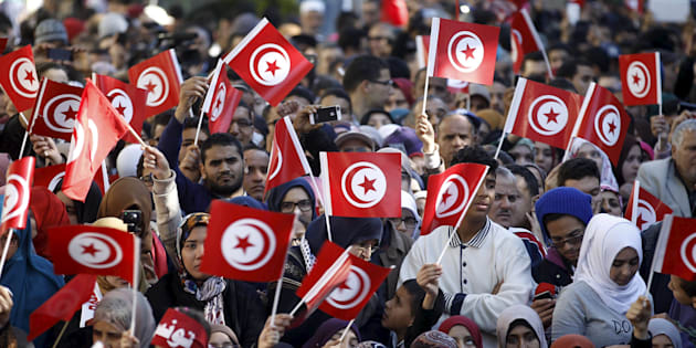 People wave national flags during celebrations marking the fifth anniversary of Tunisia's 2011 revolution, in Habib Bourguiba Avenue in Tunis, Tunisia January 14, 2016.   REUTERS/Zoubeir Souissi