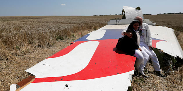 """Debris from a Malaysian Airlines Boeing 777 that crashed on Thursday lies on the ground near the village of Rozsypne in the Donetsk region July 18, 2014. The Dutch are due to announce on Wednesday 28 September the long-awaited results of an investigation with Australia, Malaysia, Belgium and Ukraine into the July 17, 2014 downing of the flight.   REUTERS/Maxim Zmeyev/File Photo          FROM THE FILES PACKAGE - SEARCH """"FILES MH17"""" FOR ALL 20 IMAGES"""