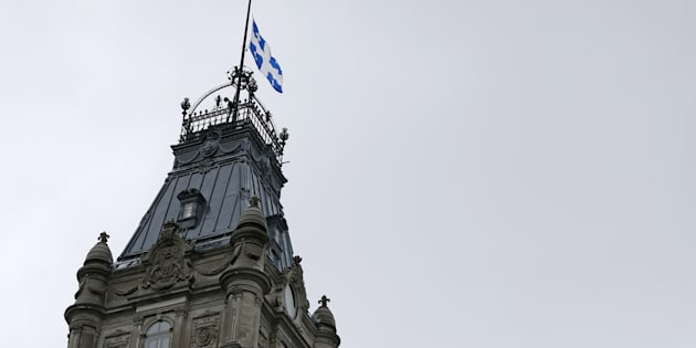 The Quebec flag is seen at half mast at the National Assembly in Quebec City, June 2, 2015.