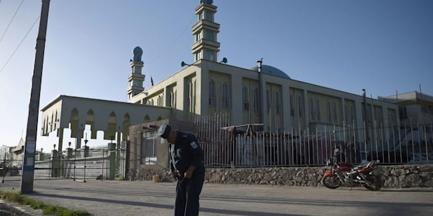 An Afghan security personnel looks at the ground in front of the Al-Zahra mosque in Kabul on June 16, 2017, after a suicide bombing attack.