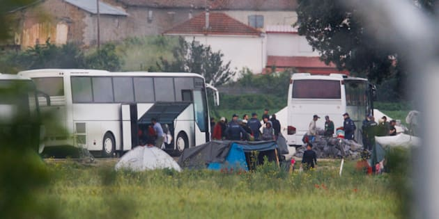 Greek policemen cleara makeshift camp for migrants and refugees at the Greek-Macedonian border.