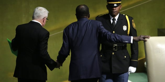 Zimbabwean President Robert Mugabe is assisted by a protocol officer (L) as he leaves the podium at 72nd United Nations General Assembly in New York this week.   REUTERS/Eduardo Munoz