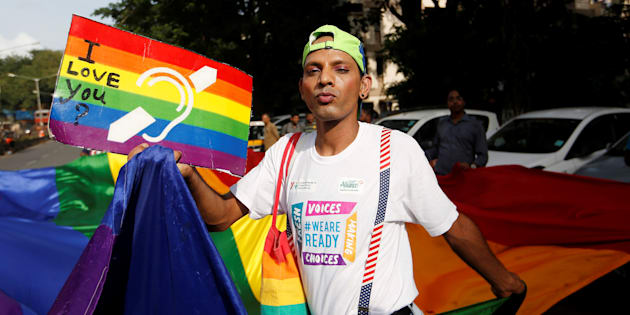 A supporter of the lesbian, gay, bisexual and transgender (LGBT) community holds a placard as he celebrates after the Supreme Court's verdict of decriminalizing gay sex and revocation of the  Section 377 law, during a march in Mumbai, India, September 6, 2018. REUTERS/Francis Mascarenhas