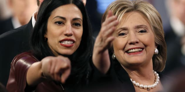 Huma Abedin, aide to Democratic U.S. presidential candidate and former Secretary of State Hillary Clinton, points as Mrs. Clinton waves to attendees at the conclusion of the second official 2016 U.S. Democratic presidential candidates debate in Des Moines, Iowa, November 14, 2015.     REUTERS/Jim Young