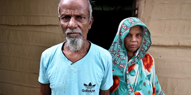 Abdul Suban, a farmer, and his wife pose for a photograph outside their home in Nellie village, in Morigaon district, in the northeastern state of Assam, India July 25, 2018.