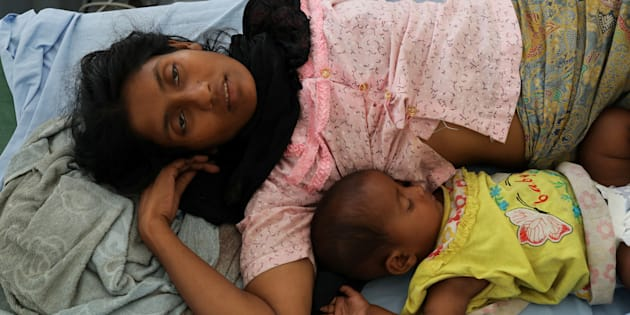 Rohingya refugee Ufaira Begom, 25, who suffers from vomits and dehydration, lies on a hospital bed with her 6-month-old baby Shehena at the Norwegian-Finnish Red Cross field hospital at Kutupalong refugee camp near Cox's Bazar, Bangladesh.