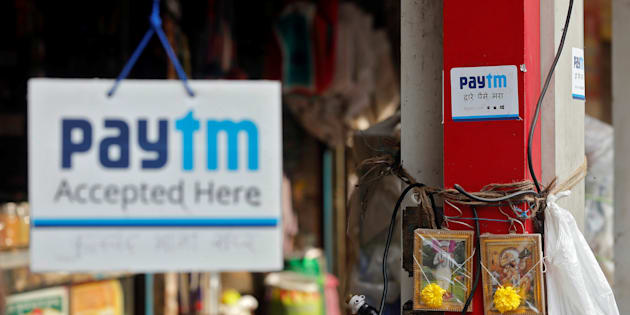 Advertisements of Paytm, a digital wallet company, are seen placed at stalls of roadside vegetable vendors in Mumbai, India, November 19, 2016. REUTERS/Shailesh Andrade