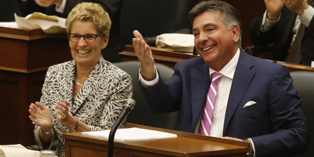 Ontario Finance Minister Charles Sousa and Ontario Premier Kathleen Wynne prepare to deliver the provincial budget at Queens Park in 2014.