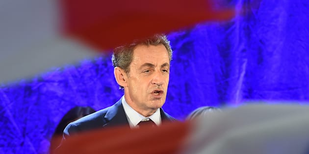 Right-wing Les Republicains (LR) party's candidate for the LR party primaries ahead of the 2017 presidential election Nicolas Sarkozy speaks during a meeting in Montauban on October 5, 2016. / AFP PHOTO / ERIC CABANIS