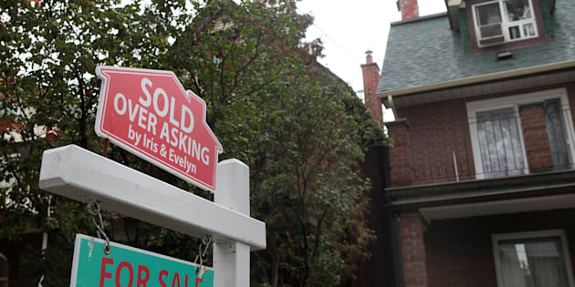 "A ""Sold over asking"" sign is on display on a house for sale in Toronto's housing market Oct. 21, 2016."