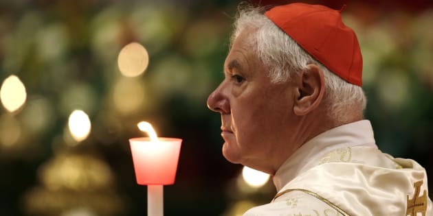 Cardinal Gerhard Ludwig Muller holds a candle as Pope Francis leads the Easter vigil mass in Saint Peter's basilica at the Vatican, April 15, 2017. REUTERS/Max Rossi