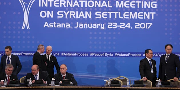 U.N. special envoy for Syria Staffan de Mistura waits with participants of Syria peace talks before a meeting in Astana, Kazakhstan January 23, 2017. REUTERS/Mukhtar Kholdorbekov