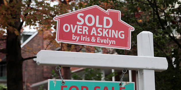 "A ""sold over asking"" sign is on display on a house for sale in Toronto, October 21, 2016."
