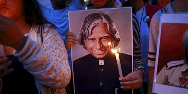 A student holds a portrait of former Indian President A. P. J. Abdul Kalam during a candle light march in Mumbai.