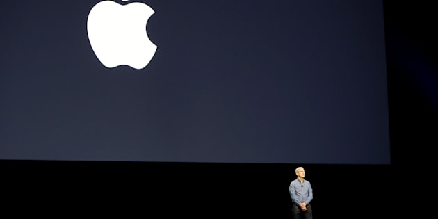 Apple Inc. CEO Tim Cook leads a moment of silence for the victims of the attack in Orlando