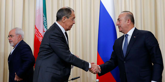 Foreign ministers, Sergei Lavrov, left, of Russia, and Mevlut Cavusoglu, right, of Turkey have reportedly agreed on a proposal for a ceasefire in Syria.