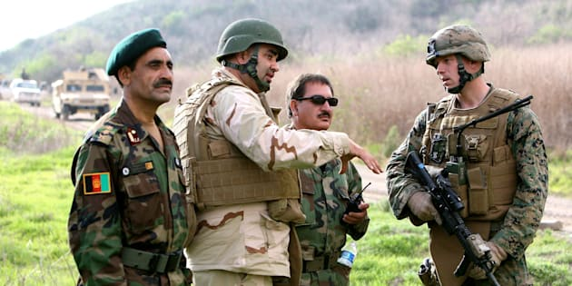 Afghan national army officers discuss lessons learned alongside Marines and Navy personnel while participating in combat scenario training exercises at U.S. Marine Corps Base Camp Pendleton in California. Dozens of Afghan troops have now gone missing.