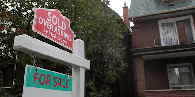 "A ""sold over asking"" sign is on display on a house for sale in Toronto, Oct. 21, 2016."