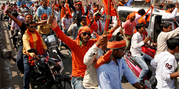 Hindu Yuva Vahini vigilante members take part in a rally in the city of Unnao, India, April 5, 2017.