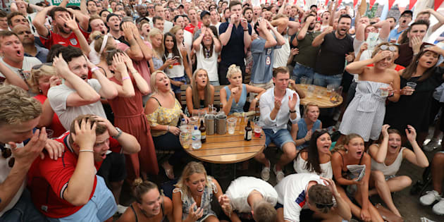 Fans react to a near miss from England while watching coverage of the FIFA World Cup 2018 quarter-final match between Sweden and England at the Rose & Crown pub in Wimbledon, south London.