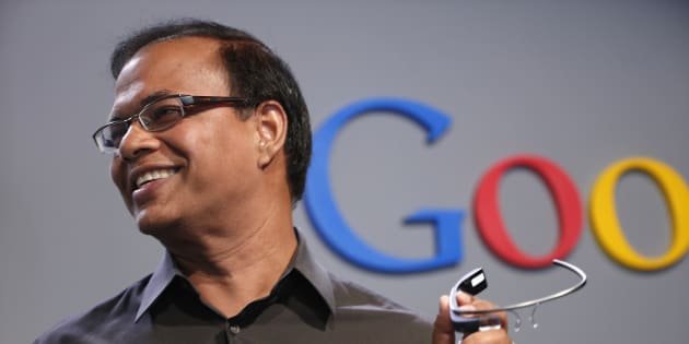 Amit Singhal, formerly senior vice president of search at Google, holds a Google Glass as he speaks at the garage where the company was founded on Google's 15th anniversary in Menlo Park, California September 26, 2013.