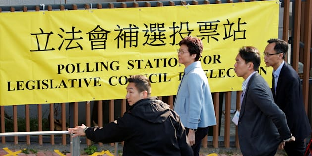 Hong Kong Chief Executive Carrie Lam arrives at a polling station to vote during a Legislative Council by-election in Hong Kong, China March 11, 2018.      REUTERS/Bobby Yip