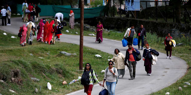 Hindu pilgrims arrive after visiting the Amarnath cave shrine where they worship an ice stalagmite that Hindus believe to be the symbol of Lord Shiva, in Pahalgam town in south Kashmir's Anantnag district.