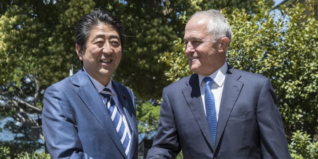 Japanese Prime Minister Shinzo Abe is greeted by the Australian Prime Minister Malcom Turnbull on arrival at Kirribilli House in Sydney, Australia.