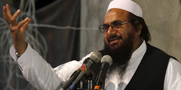 Hafiz Muhammad Saeed, chief of the Jamat-ud-Dawa religious party, addresses the Harmain Sharifain Conference in support of the Saudi Arabian government in Peshawar April 19, 2015.