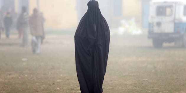 A woman wearing a burka leaves a polling booth after voting during the state assembly election, in the town of Deoband, in the state of Uttar Pradesh, India, February 15, 2017.