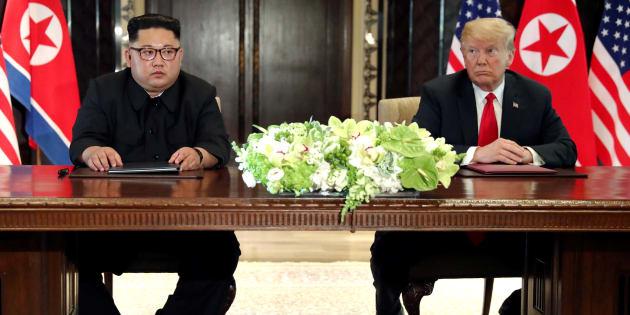 Donald Trump y Kim Jong-un durante la ceremonia para dar por terminada la cumbre de Singapur en el Hotel Capella en la Isla de Sentosa.