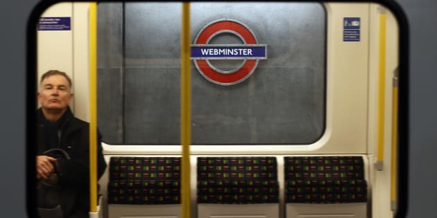 A tube train passes a sign reading 'Webminster' after Amazon rebranded Westminster tube station as a marketing stunt in central London, Britain January 12, 2017. REUTERS/Stefan Wermuth