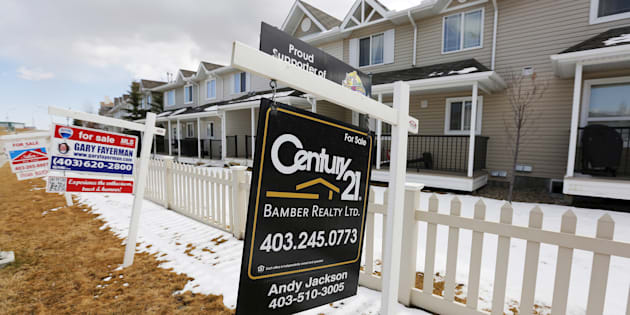 For sale signs line in Calgary, Alta., April 7, 2015. Calgary was among the cities that saw falling house prices in January, according to the Teranet-National Bank house price index.