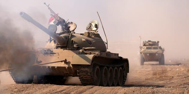 Military vehicles of Kurdish peshmerga forces roll towards Mosul.