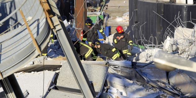 Members of the rescue team search through the debris of the collapsed control tower of the Genoa's port May 8, 2013. Six people were killed and three are missing after a container ship crashed into a control tower in the northern Italian port of Genoa, rescuers said on Wednesday. The tower, which was more than 50 metres (160 feet) high and looked much like the ones common at airports, collapsed into the water late on Tuesday after being struck by the prow of the vessel, the Jolly Nero.     REUTERS/Alessandro Garofalo (ITALY - Tags: MARITIME DISASTER TRANSPORT)