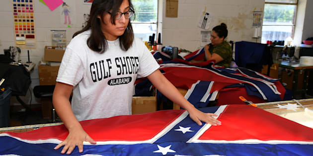 Cynthia Hernandez places stars on a Confederate Battle Flag in the Alabama Flag & Banner shop in Huntsville, Alabama, U.S., August 24, 2017.