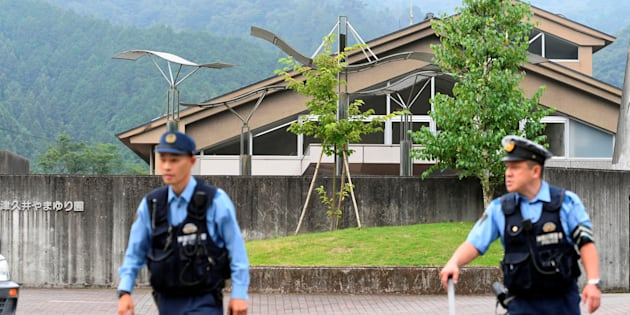 Police officers in front of the facility for the disabled where 19 people were killed and 25 wounded by a knife-wielding man, in Sagamihara, Kanagawa prefecture, Japan.