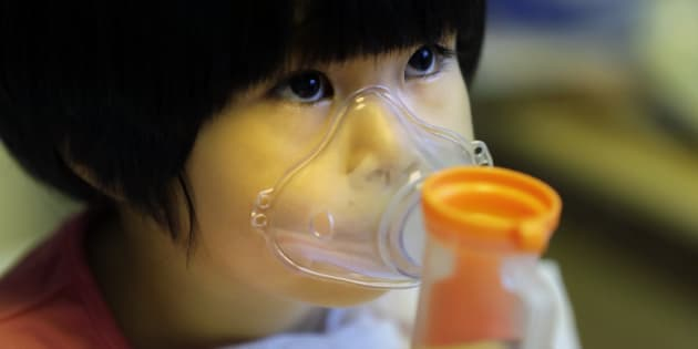 A two year old in Beijing receives nebuliser therapy during a pollution 'red alert' in 2015.