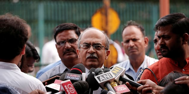 FILE PHOTO: Prashant Bhushan, a senior lawyer, speaks with the media after a verdict on right to privacy outside the Supreme Court in New Delhi, India August 24, 2017. REUTERS/Adnan Abidi