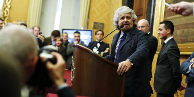"Leader of ""5-Star"" movement and comedian Beppe Grillo talks to reporters at the end of the consultations with Italian Prime Minister-designate Matteo Renzi (not pictured) at the Parliament in Rome February 19, 2014. Centre-left leader Renzi began the delicate task of trying to form a new government on Tuesday, facing questions about how he will fill key ministerial posts and the details of his ambitious reform agenda. REUTERS/Tony Gentile (ITALY - Tags: POLITICS)"