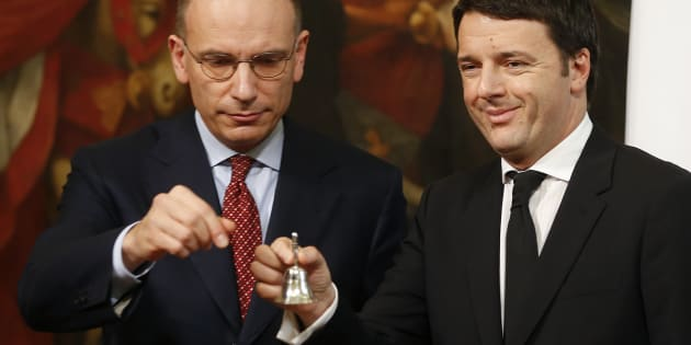 Newly appointed Italian Prime Minister Matteo Renzi (R) rings a silver bell to signify the start of his first cabinet meeting, next his predecessor Enrico Letta (L), at Chigi Palace in Rome February 22, 2014. Italian center-left leader Matteo Renzi promised on Friday to start work on reforms immediately, after he named a new cabinet and formally accepted the mandate to form an administration he said would stay in place until 2018. REUTERS/Tony Gentile  (ITALY - Tags: POLITICS TPX IMAGES OF THE DAY)