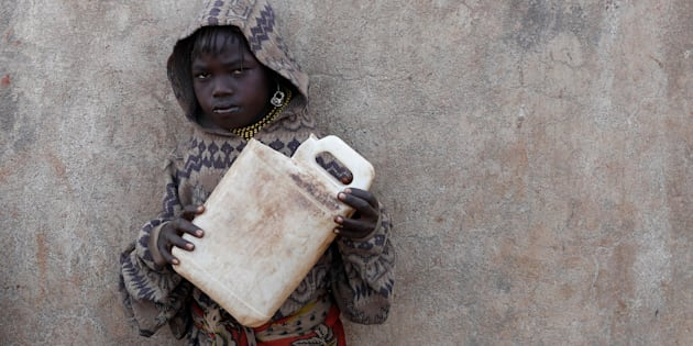 A Turkana girl holds a canister as she waits to get water from a borehole near Baragoy, Kenya, in February.