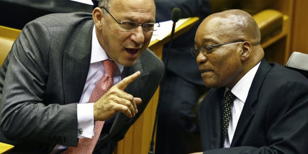 South Africa's Finance Minister Trevor Manuel chats with ruling African National Congress President Jacob Zuma in Parliament in Cape Town during the swearing in of members and the formal election of the country's president, May 6, 2009.