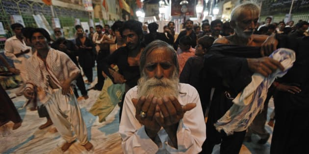 A devotee prays at the shrine of Sufi saint Syed Usman Marwandi, also known as Lal Shahbaz Qalandar, in Sehwan Sharif, in Pakistan's southern Sindh province, September 5, 2013.
