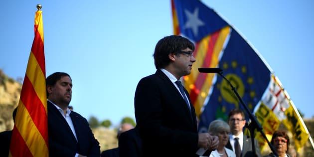 "Catalan President Carles Puigdemont delivers a speech at the memorial of ""Fossar de la Pedrera"" (Pedrera mass grave) in Barcelona, Spain, October 15, 2017. REUTERS/Ivan Alvarado"
