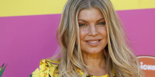 Singer Fergie arrives at the 2013 Kids Choice Awards in Los Angeles, California March 23, 2013. REUTERS/Patrick T. Fallon   (UNITED STATES - Tags: ENTERTAINMENT)
